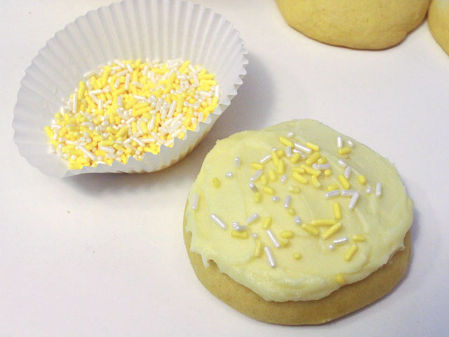 Add sprinkles to the Lemon Cookies with Lemon Frosting
