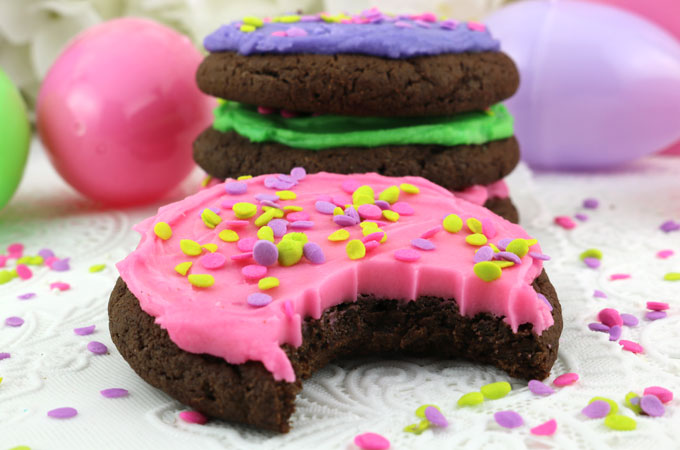 Springtime Frosted Chocolate Cookies - sweet, chocolatey and covered with our deliciously creamy Best Buttercream Frosting. These yummy frosted cookies are easy to make and super delicious to eat. This cookie recipe would be a great dessert for Easter, Mother's Day, a Spring Brunch or just as a special treat for that chocolate-lover in your family. Pin this tasty Easter dessert for later and follow us for more great Easter Food Ideas.