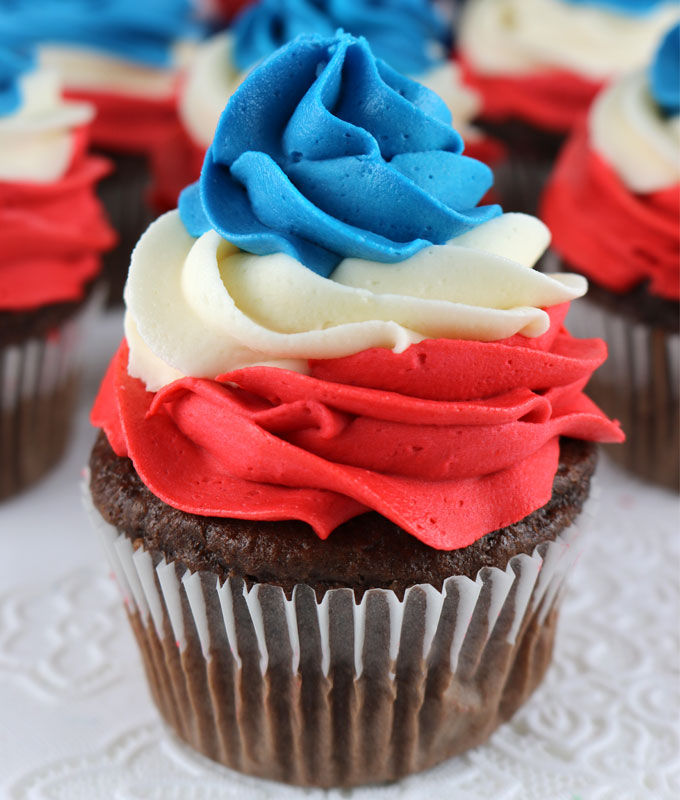 Patriotic Swirl Cupcakes - This easy to make red white and blue cupcake recipe is perfect for a 4th of July party or Memorial Day barbecue and tastes amazing. These yummy 4th of July treats feature our Best Buttercream Frosting in patriotic colors and they are sure to become your go-to 4th of July dessert. Pin this 4th of July Cupcake for later and follow us for more great 4th of July food ideas.