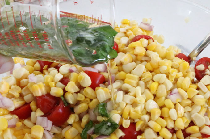 Add dressing to the Corn and Avocado Summer Salad
