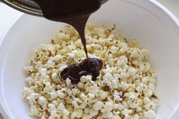 Pour Chocolate Marshmallow Mixture into the popcorn