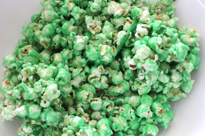 Mix the mint marshmallow mixture with the popcorn