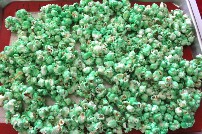 Pour the popcorn out onto a cookie sheet