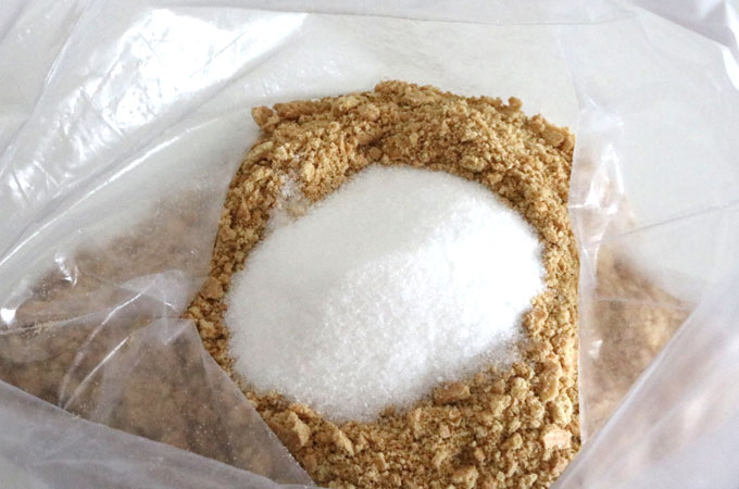 Add sugar to the graham cracker crumbs