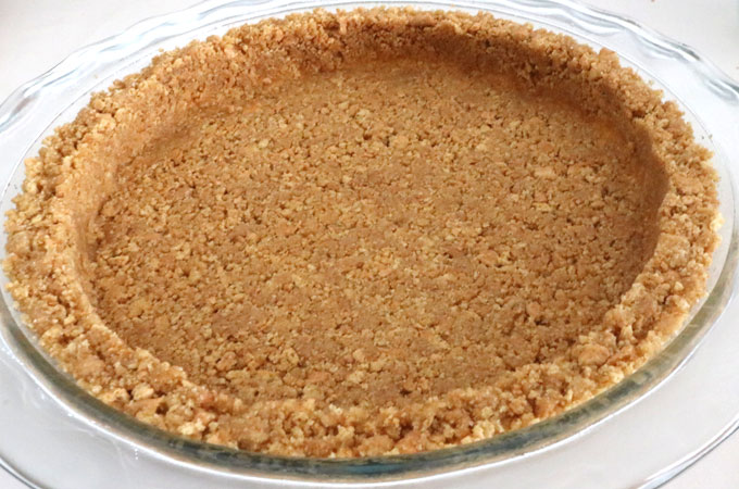 We show you How to Make Graham Cracker Crusts that are super easy to make, can be bake or no-bake and taste better than anything you can buy in the store. This is the Best Graham Cracker Crust recipe that you are going to find. Pin this Perfect Graham Cracker Crust recipe for later and follow us for more pie crust recipe ideas.