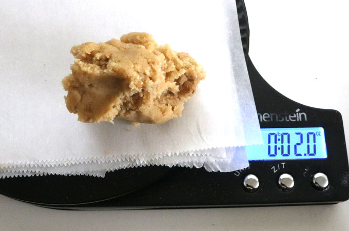 Measuring cookie dough ball for Toffee Chip Cookies