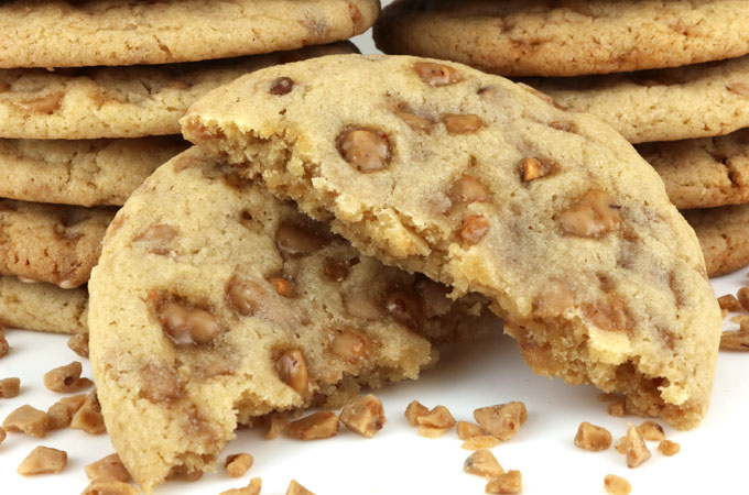 Toffee Chip Cookies - If you are looking for a chewy, buttery cookie chock full with caramel Heath English Toffee Bits, look no further. These easy to make Toffee Chip Cookies are the homemade toffee cookies you've been seeking.  Pin this melt in your mouth caramel cookie recipe for later and follow us for more yummy cookie ideas.