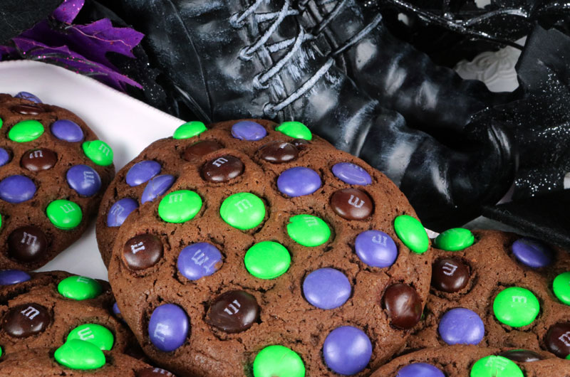 Bewitched M&M Cookies - super yummy, easy to make and chock full of colorful M&M's.  This cookie recipe is a fun Halloween cookie that your family will clamor for. This is a Halloween dessert that will wow the guests at your Halloween party.  Pin this delicious Halloween treat for later and follow us for more great Halloween Food Ideas.