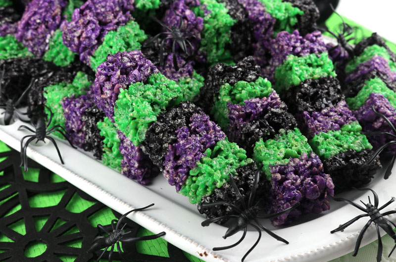Our colorful and spooky Bewitched Rice Krispie Wands are adorable, delicious and make the perfect Halloween dessert. Easy to make, these super cute Halloween Treats will definitely stand out on a Halloween Dessert Table. They would be great at a Halloween party. Pin this delicious Halloween snack for later and follow us for more great Halloween Food Ideas.