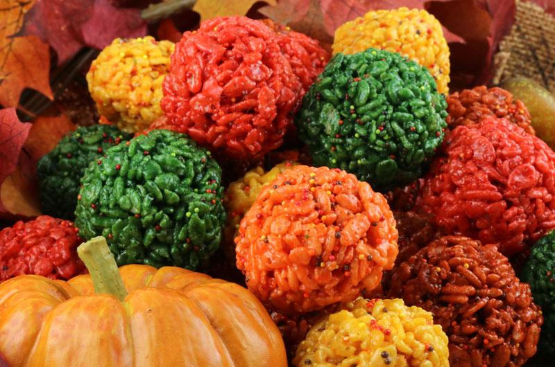 Fall Harvest Rice Krispie Bites - Yummy, bite-sized balls of crunchy, marshmallow-y delight in beautiful Fall Colors are a great Fall or Thanksgiving treat.  This is a Thanksgiving dessert that is easy to make and even better to eat.  These colorful and festive Rice Krispie Treats are great for Fall potluck, a family dinner or a fun Thanksgiving dessert. Pin this Fall Treat for later and follow us for more fun Thanksgiving Food Ideas.
