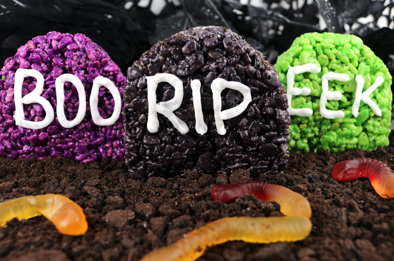 Graveyard Rice Krispie Treats - a colorful, yummy and festive Halloween dessert that is both spooky and adorable. Easy to make, these super cute but also creepy Halloween Treats will definitely stand out on a Halloween Dessert Table. They will be a hit at your Halloween party. Pin this delicious Halloween snack for later and follow us for more great Halloween Food Ideas.