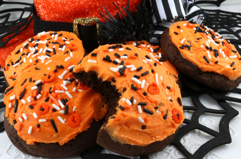 Halloween Chocolate Cookies - sweet, chocolatey and covered with our deliciously sweet Best Buttercream Frosting. These yummy frosted cookies are and easy to make Halloween treat. And they will really stand out on your Halloween Party Dessert Table. Pin this yummy Halloween Dessert for later and and follow us for more great Halloween Food Ideas.