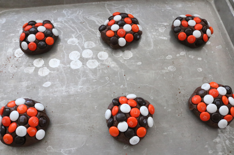 Press M&Ms into the chocolate cookie dough