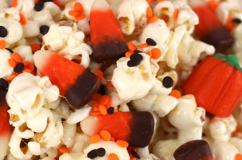 Harvest Corn Popcorn - a fun Halloween treat. Sweet, salty, crunchy and delicious and chock full with classic Halloween candy. It would be a great Halloween Party Food or Fall movie night dessert! Pin this Halloween Dessert for later and follow us for more fun Halloween Food ideas.