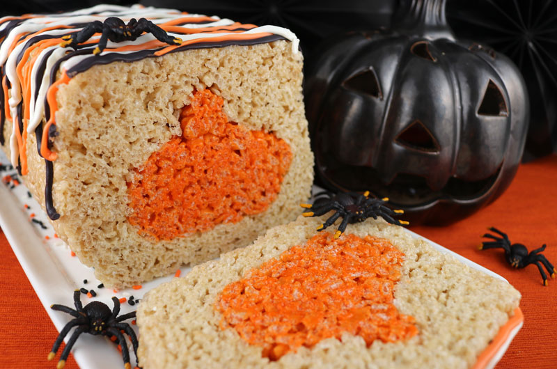 Pumpkin Rice Krispie Cake - adorable, delicious and fun! This lovely Halloween Dessert will be a hit with your family or your party guests, we've never met anyone who doesn't love Rice Krispie Treats. This fun Halloween Treat would be perfect for a Holiday Bake Sale or a Halloween family movie night. Pin this Rice Krispie Treat recipe for later and follow us for more great Halloween Food Ideas recipes.