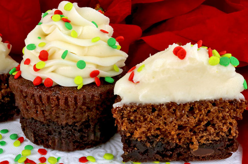 Brownie Gingerbread Cupcakes are a unique twist on a classic - brownies plus homemade gingerbread plus buttercream frosting in one unique and delicious Christmas Cupcake. So easy to make and they taste as amazing as they look! Your family, friends and Holiday party guests will be impressed when you serve this super yummy two-in-one dessert. What a fun and delicious Christmas Treat. Pin this easy Christmas Dessert for later and follow us for more great Christmas Food ideas. #ChristmasCupcakes #ChristmasDesserts #ChristmasTreats