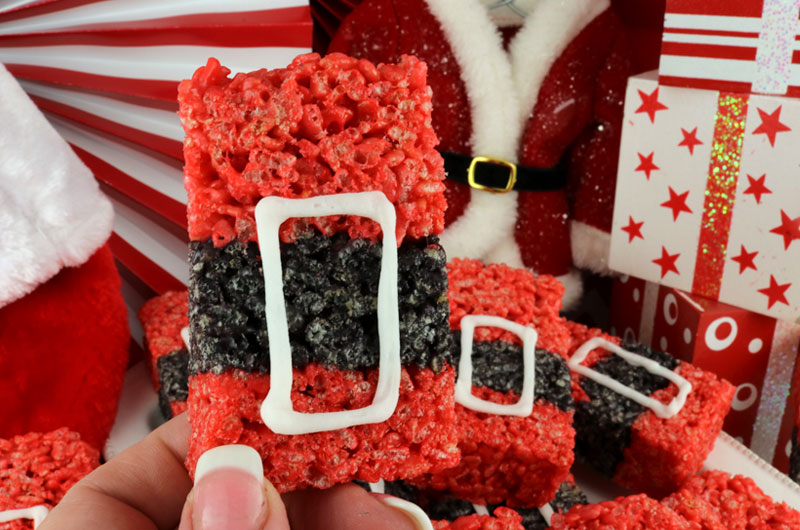 Santa Claus Rice Krispie Treats - a festive and fun Holiday dessert that will wow both your family and your Christmas Party guests. Easy to make, these super cute Christmas Treats will definitely stand out on a Holiday Dessert Table. They would be a great Christmas party food. Pin this delicious Christmas snack for later and follow us for more great Christmas Food Ideas.