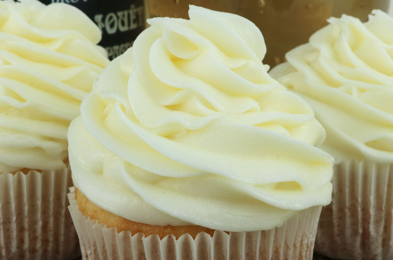 Champagne Buttercream Frosting - a creamy buttercream frosting infused a hint of champagne flavor. A great choice for when you need a special occasion treat or dessert for New Year's Eve, Christmas or Valentine's Day. This yummy homemade butter cream frosting will take your cake and cupcakes to the next level, we promise! Pin this tasty Champagne Icing for later and follow us for more great Frosting Recipes! #Frosting #ChampagneFrosting #Icing #Buttercream #ButtercreamFrosting #FrostingRecipes