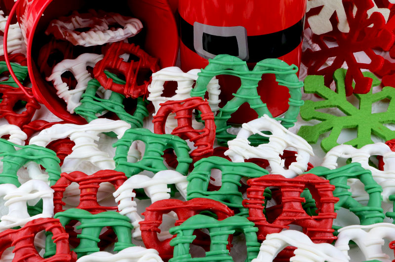 Christmas Pretzels - sweet, crunchy and delicious - an easy to make Christmas Dessert that would be fun to serve at a Christmas Party or give as a Holiday Gift. The kids will love to help make this delicious Christmas treat. Pin this yummy Christmas Candy for later and follow us for more fun Christmas Food Ideas. #ChristmasDessert #ChristmasTreats #ChristmasCandy #ChristmasFood